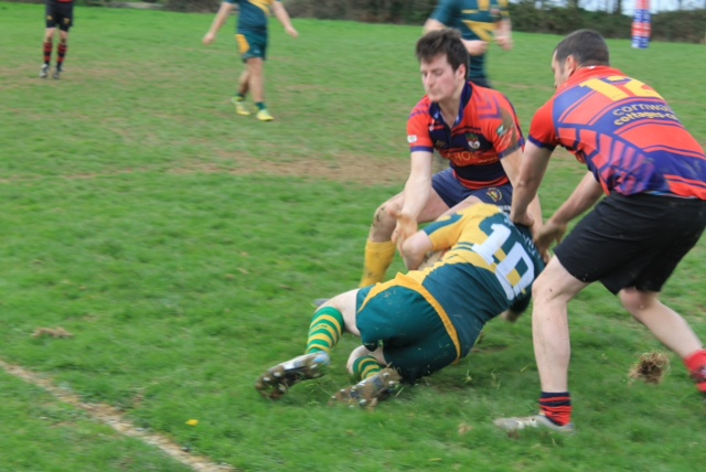 Ali Hill and Sam Glanville go in for the tackle